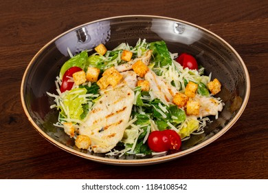 Caesar salad with chicken and cheese