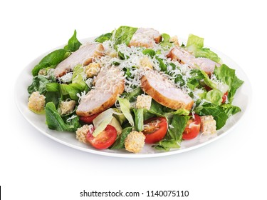 Caesar salad with chicken fillet and parmesan cheese isolated on white background. With clipping path.