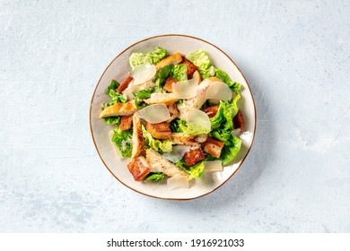 Caesar salad with chicken, romaine and Parmesan, shot from the top