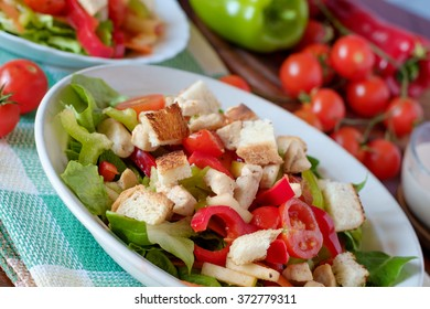 Caesar salad with croutons, dressing, chicken, cherry tomatoes