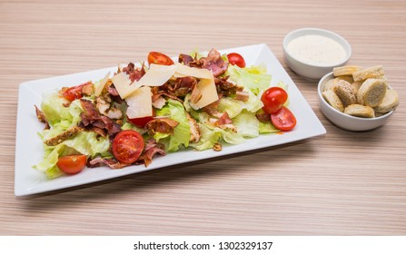 Caesar salad with fresh pastry and caesar dressing