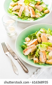 Caesar salad with grilled chicken, cheese and croutons