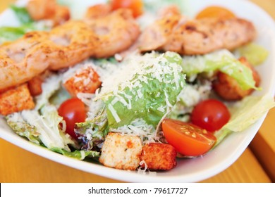 Caesar salad with grilled chicken fillet, parmesan and croutons