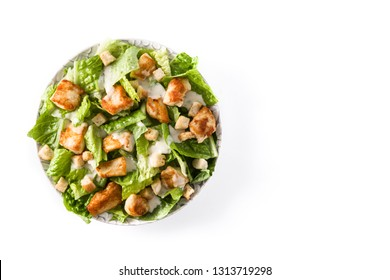 Caesar salad with lettuce,chicken and croutons isolated on white background. Top view. Copyspace