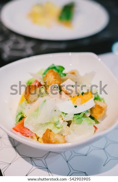 caesar salad on plate