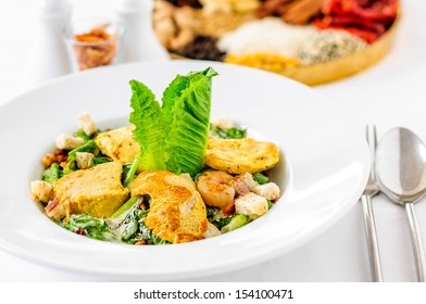 Caesar Salad on the white dish.