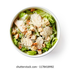 Caesar salad in paper bowl for take away, isolated on white background, top view