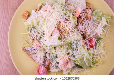 Caesar Salad with shrimps and croutons, cherry tomatoes and lettuce leaves