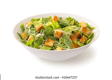 Caesar salad in a white plate isolated
