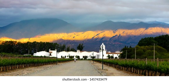 """Cafayate, Argentina - December 4, 2014: Road to the old colonial wine maker 'Bodega El Esteco"""" in Cafayate with the mountains and clear blue sky in the background"""