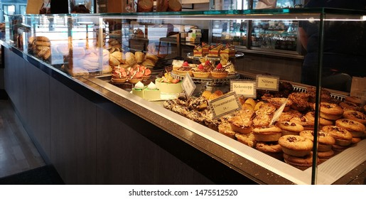 cafe bar counter with cakes and bread