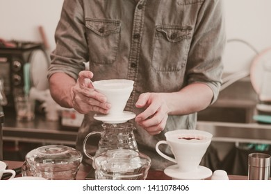 Cafe barista making specialty coffee with coffeee filter  in a cafe