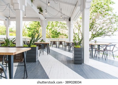 cafe by the sea, summer terrace, empty table