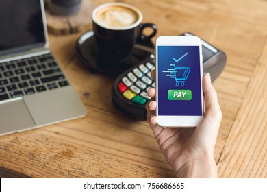 cafe coffee making show shopping transfer payment through smartphone app Mobile Payment with NFC technology on phone store shopping online display green button text pay and shopping cart on screen