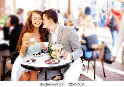 Cafe couple drinking talking having fun laughing smiling happy