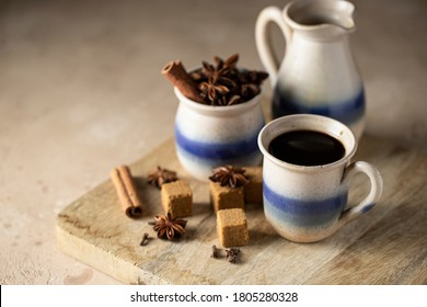 Cafe de olla, traditional Mexican coffee beverage with panela and spice and prepared in clay pot.