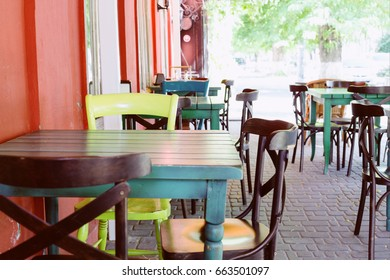 Cafe with different color chairs. Tolerance. View of terrace on the street