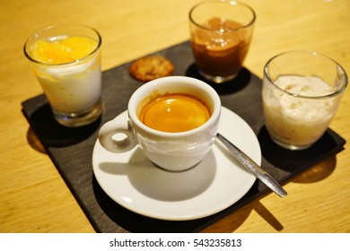 A cafe gourmand platter with coffee and dessert in France