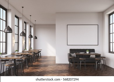 Cafe interior with a large sofa near a white wall, a row of tables with chairs near windows and a big horizontal poster on the wall. 3d rendering. Mock up.