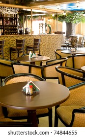 cafe interior with round tables and cosy armchairs