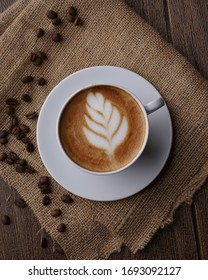 """Cafe Latte, a coffee drink made with espresso and steamed milk. The word comes from the Italian caffé e latte, cafelatte or caffellatte, which means """"coffee and milk""""."""