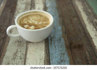 cafe latte on the pastel wooden