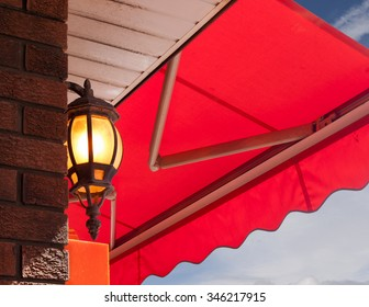 Cafe light and red awning