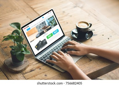 cafe making  shopping transfer payment through  app web pay with creditcard  on notebook shopping online