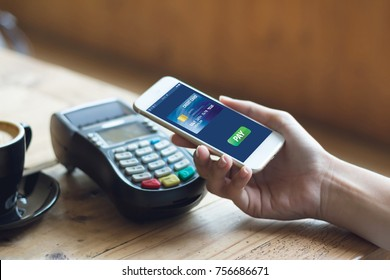 cafe making show shopping transfer payment through smartphone app Mobile Payment with NFC technology on phone shopping store online and  pay with credit card concept
