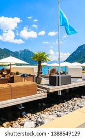 Cafe on pier on shore of beautiful Achensee lake on sunny summer day, Tirol, Austria