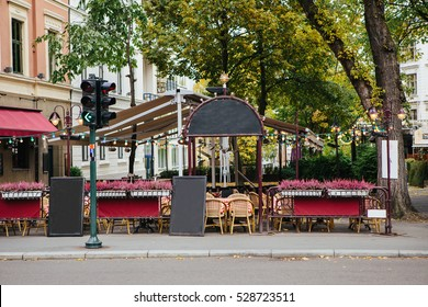 Cafe on the streets of the city. Traditional architecture of Europe.