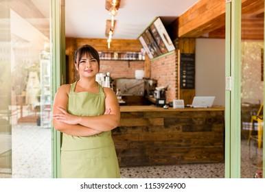 Cafe owner posing at camera.