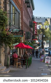 Cafe Paloma and street signs in Pioneer Square, Downtown, Seattle, Washington, USA, North America 21 September 2017