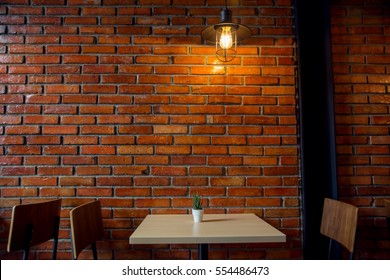 Cafe or Restaurant Decorate with Red Brick Wall and Industrial loft lamp