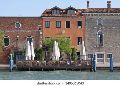Cafe Restaurant Terrace at Canal in Venice Italy