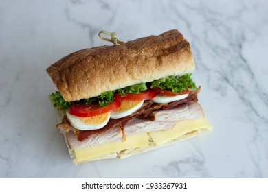 Cafe - Sandwich with bacon, cheese, ham and vegetables