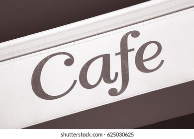 Cafe Sign on Diagonal Slant in Black and White Sepia Tone