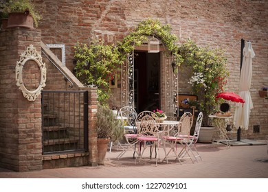 cafe. Small patio. tables and chairs  at the city Certaldot. Tuscany, Italy
