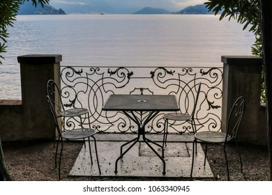A cafe table with chairs in a lakeside