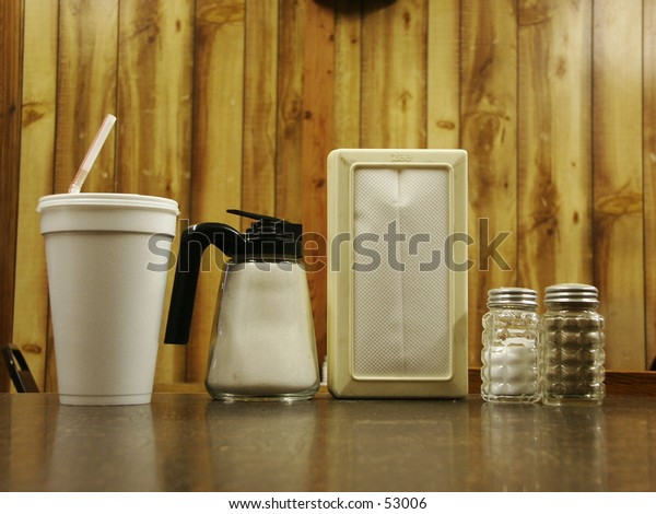 Cafe table with condiments