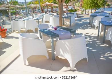 cafe tables on the coast of Georgioupolis (Greece, Crete)