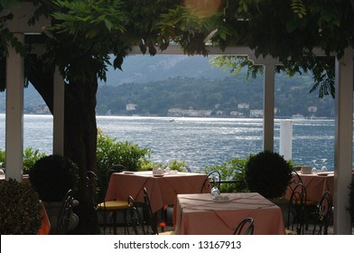 cafe tables on the edge of lake como, italy