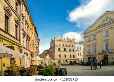 Cafe Terrace on Lublin street. View in old town with tourists, shops and restaurants. Lublin is Polish city east of Vistula River near Warsaw. City Lublin, Poland: September 2018. Beautiful summer day