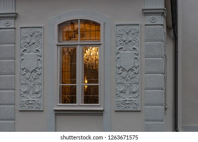 cafe window facade with lustre at evening in historical city of south germany