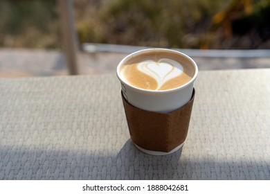 cafelatte in a cardboard cup
