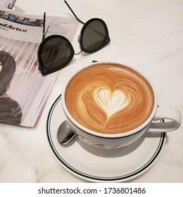 cafelatte and newspaper in cafe