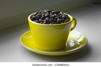 Caffe beans in yellow cup