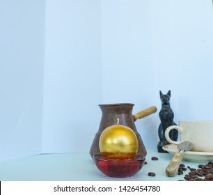 caffe cooker, caffe cup, cat, candle and coffee beans