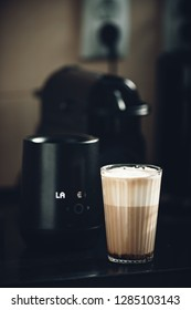 caffe latte at home in the kitchen with milk foam froth