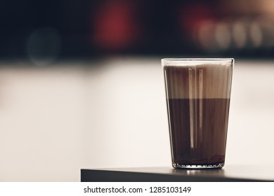caffe latte at home in the kitchen with milk foam on the table